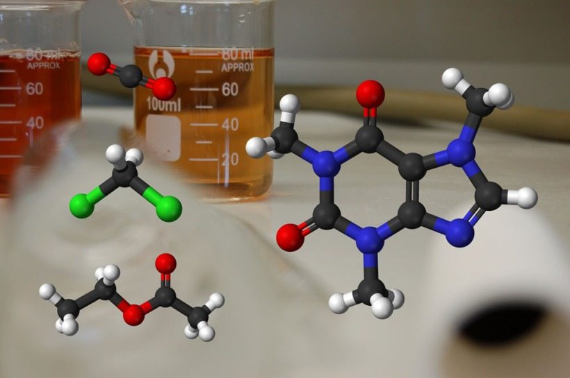 A model of the caffeine molecule (right), alongside some decaffeination solvents (top to bottom: carbon dioxide, dichloromethane, ethyl acetate).