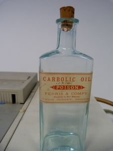One of the numerous bottles of carbolic acid, a Victorian cure-all…?
